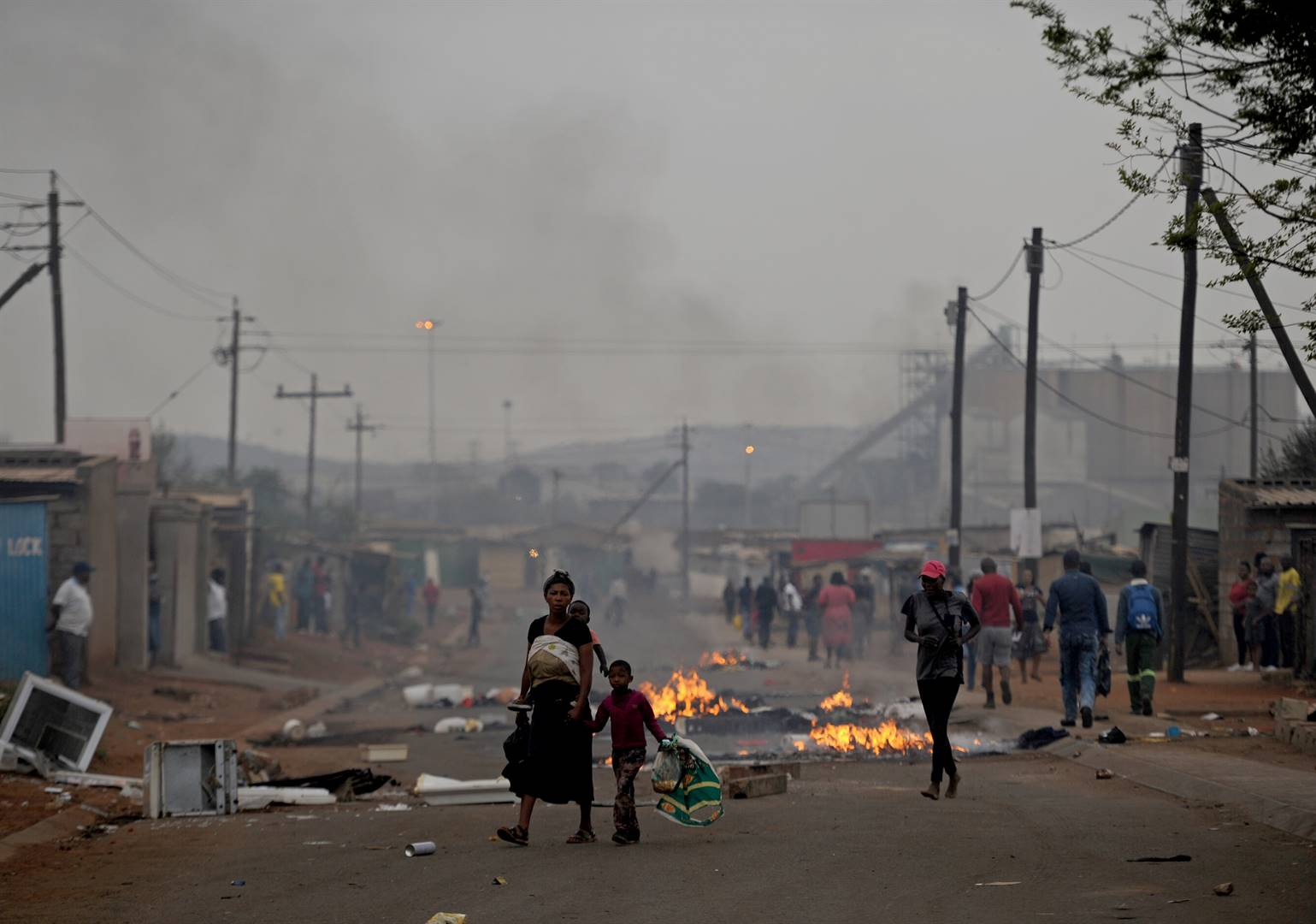 Property belonging to foreign nationals goes up in smoke in Katlehong Zone 3, Mandela section, as community members turn against them. Picture: Tebogo Letsie/City Press