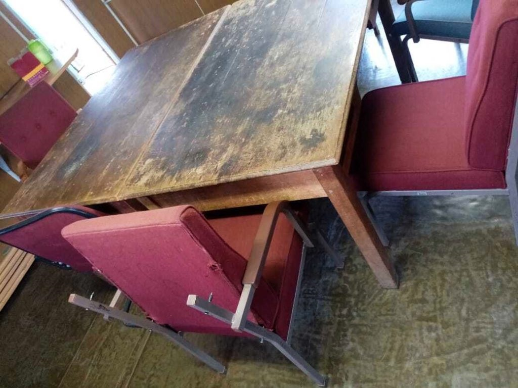 Table and chairs used in makeshift courtroom