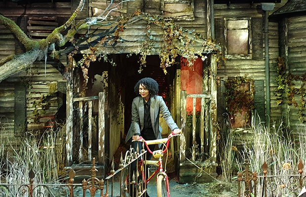 Leandra Engelbrecht in front of the Haunted House