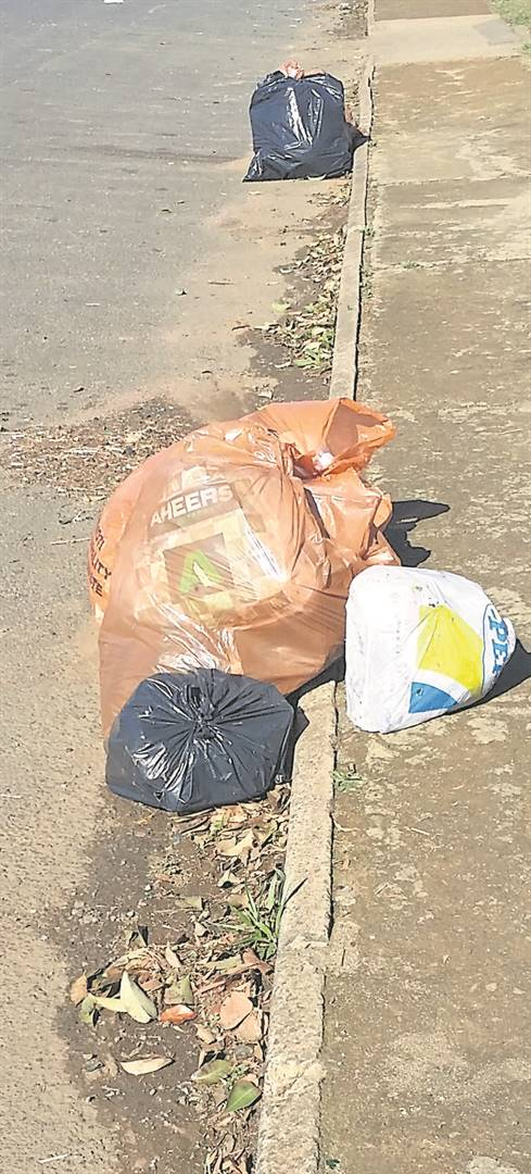 Some of the bin bags that were not collected, lined up in Pine Street. photo: andile sithole