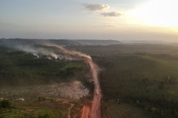 """In this aerial view the red dust of the BR230 highway, known as """"Transamazonica"""", mixes with fires at sunset in the agriculture town of Ruropolis, Para state, northern Brazil. (Johannes Myburgh, AFP)"""