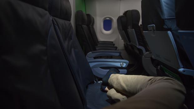 Passenger asleep during flight (Photo: Getty/Gallo