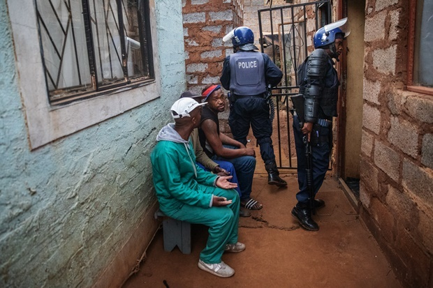 eMembers of the Ekurhuleni Metropolitan Police search the house of a resident of Johannesburg's Katlehong township as South Africa's financial capital is hit by a new wave of anti-foreigner violence. (Michele Spatari, AFP)