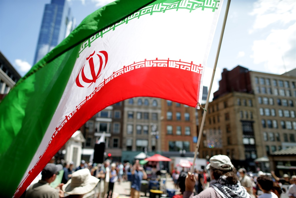 BOSTON, MA - JUNE 22: The flag of Iran is waved at