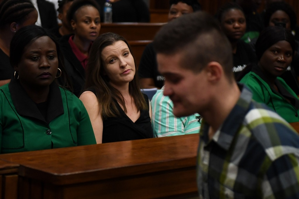Nicholas Ninow's mother, Chantelle watches on as he leaves court.. (Deaan Vivier)