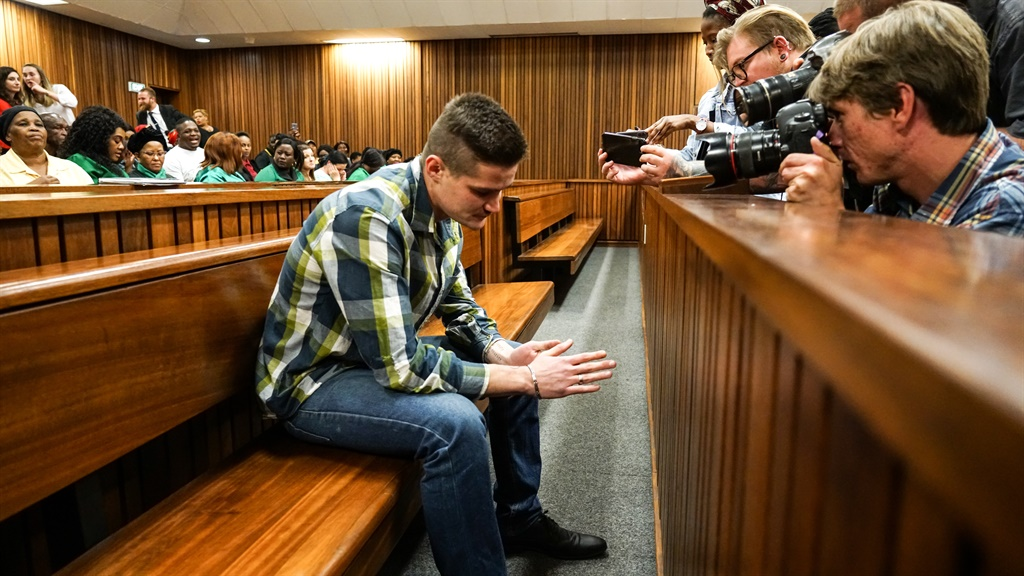 Twenty-two-year-old Nicholas Ninow sat in front of a filled gallery for the second day of trial at the Gauteng High Court in Pretoria on Tuesday. (Chanté Schatz, News24)