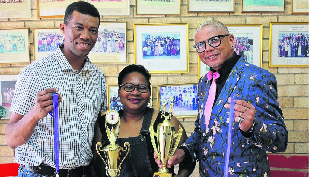 Nathaniel Pietersen from Love Life sponsored the trophies and medals for the recent Dalrose Family Sports Day fundraiser. From left are Nathaniel Pietersen, Beronice Mitchell and Larry Craig de la Harpe.