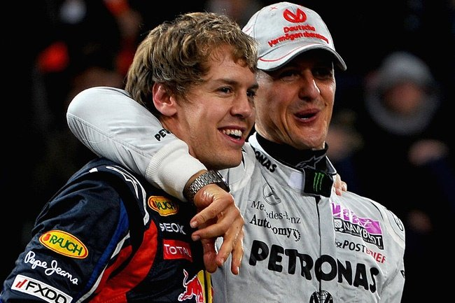 Sebastian Vettel (L) and Michael Schumacher (R) celebrate after winning the Nations Cup at day one of the race of champions event at the Esprit Arena on December 3, 2011 in Duesseldorf, Germany.