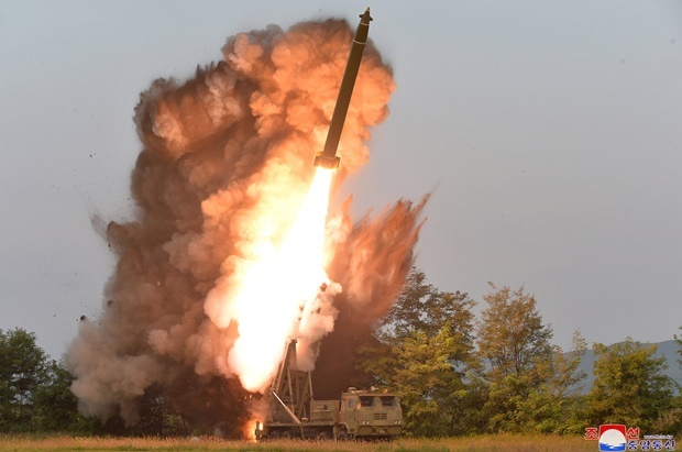 "A test firing of a ""super-large multiple rocket launcher"" at an undisclosed location in North Korea. (KCNA via KNS, AFP)"