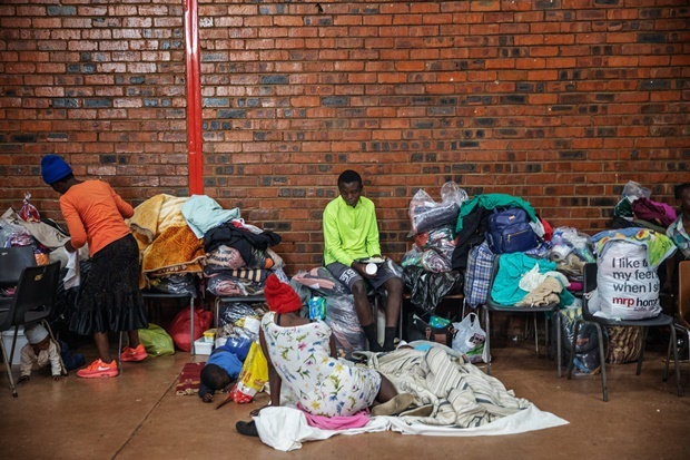 Around 250 people, mostly Zimbabwean and Malawian nationals, are hosted at a Johannesburg community hall after being displaced due to a new wave of anti-foreigner violence that hit the financial capital. (Michele Spatari, AFP)