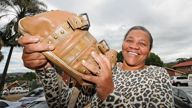 Thamally Ndlovu with her handbag that was found on her doorstep a few days after it had been stolen from Brookside Mall.