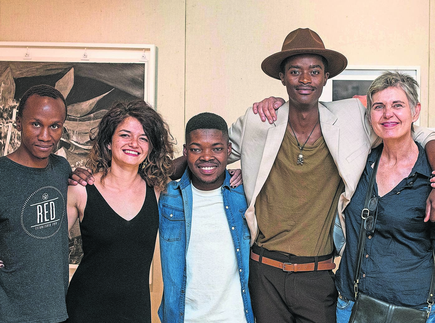 The body of artwork produced by the winners of the 2019 Phatshoane Henney Attorneys New Breed Art Competition is on exhibition. These 25 pieces are on show in the foyer of the law firm's offices at 35 Markgraaff Street, Westdene, Bloemfontein, on weekdays from 08:00 to 17:00. They can also be viewed online as part of a virtual exhibition to allow art lovers worldwide to enjoy an immersive art experience. The virtual exhibition is accessible until 31 October without charge on newbreedart.co.za. From the left are Bokang Nkejane, Miné Kleynhans, Neo Theku, Bongani Tshabalala and Kay Fourie. Photo: Eye Poetry Photography