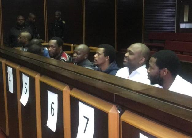 he eight accused in the Glebelands hostel case sit in the Pietermaritzburg High Court. (Nompendulo Ngubane , GroundUp)