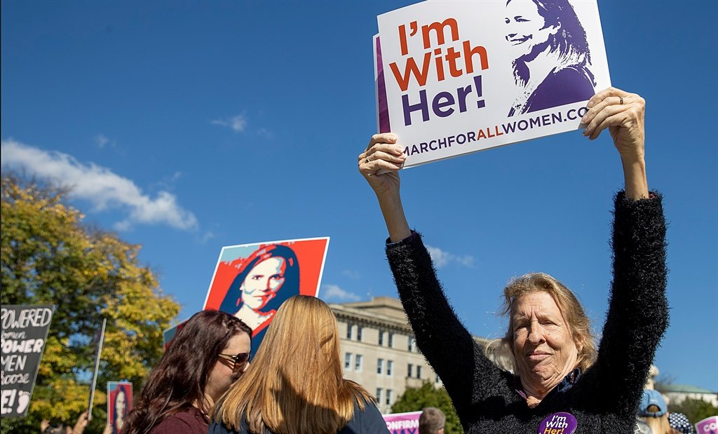 supporters of amy coney barrett during womens marc