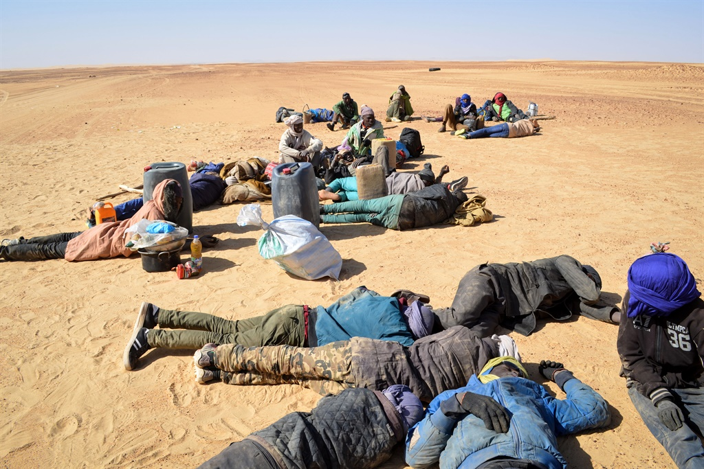 A group of migrant men, mainly from Niger and Nigeria, have a rest. (Soulemaine Ag Anara, AFP)