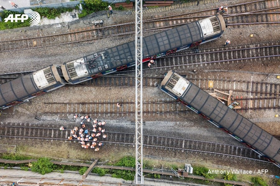 A passenger train derailed during the morning rush hour in Hong Kong leaving eight people injured. (Twitter, AFP)
