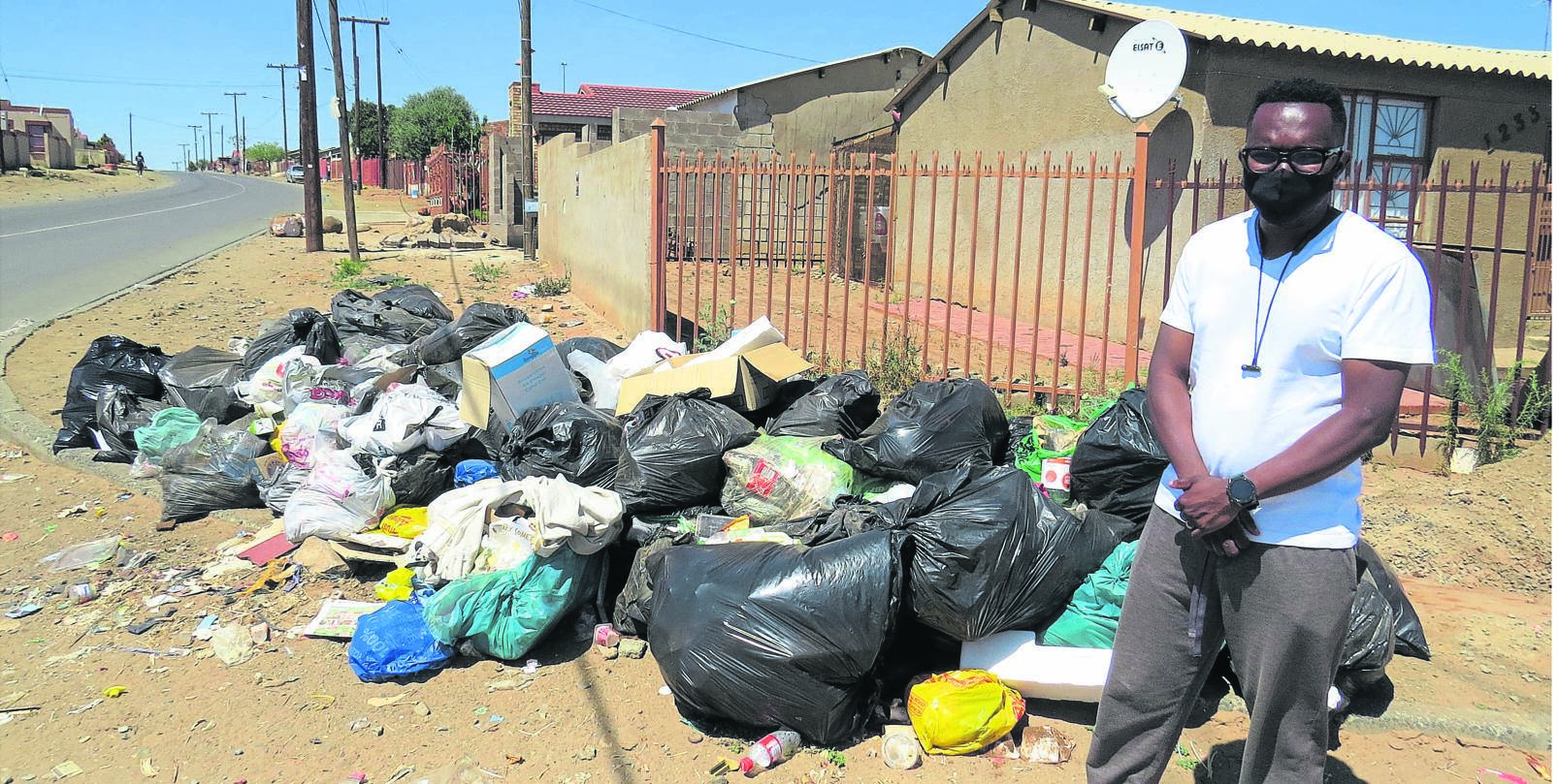Bokang Moleme, owner of the house on the corner of Pele Street and Makoane Road in Rocklands, Bloemfontein, battles the stench of uncollected refuse rotting.Photo: Teboho Setena