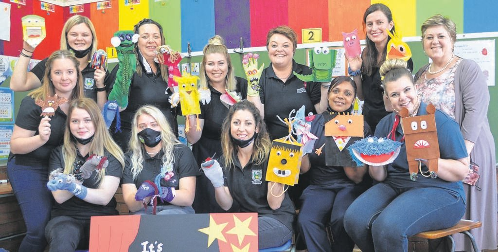"""A group of student teachers at Despatch Preparatory with the hand puppets they made for the """"Literacy Revolution"""" project. In front from left areLeonné Herridge, Tashrika Lombard, Madelie van Jaarsveld, Neevra Bellingan, Vanessa Maarman, Shenel van Rensburg. At the back are Kayleigh Leonard, Ansie Harvey, Marinel Botha, Asja Strydom, Natasha van Tonder and Madeléne Sachse (principal at Despatch Preparatory School).                                                                                PHoto:HEILIE COMBRINCK"""