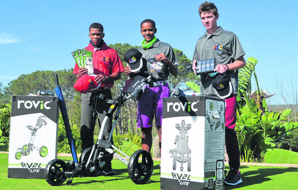 These young golfers from the South African Golf Development Board's Uitenhage region received various golfing items sponsored by the National Lottery. From left are Marcello Jantjies, Devon Valentine and Shane Hayward showing the items they received. (See full story on p. 12) Photo:HEILIE COMBRINCK