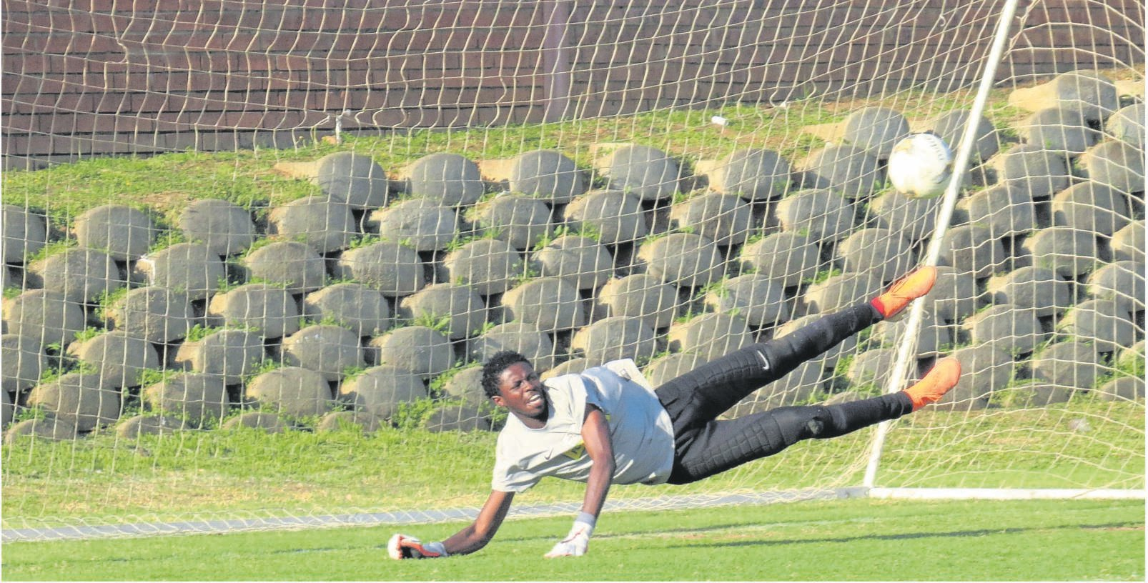 The Central University of Technology's (CUT) goalkeeper, Reatile Mafa, makes an acrobatic save to deny the Kovsie side a goal in their Nedbank Cup preliminary knockout game in Boemfontein on Saturday (21/09).Photo: Teboho Setena