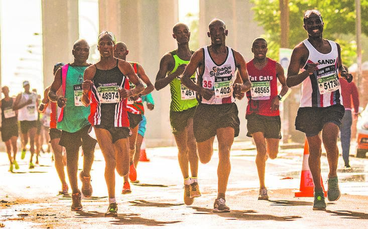 Runners take on the heat and the challenging route around Kliptown in last year's Soweto Marathon. Picture: Jetline Action photo
