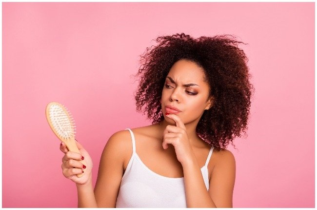 Woman wonders what type of brush to use on her hair.