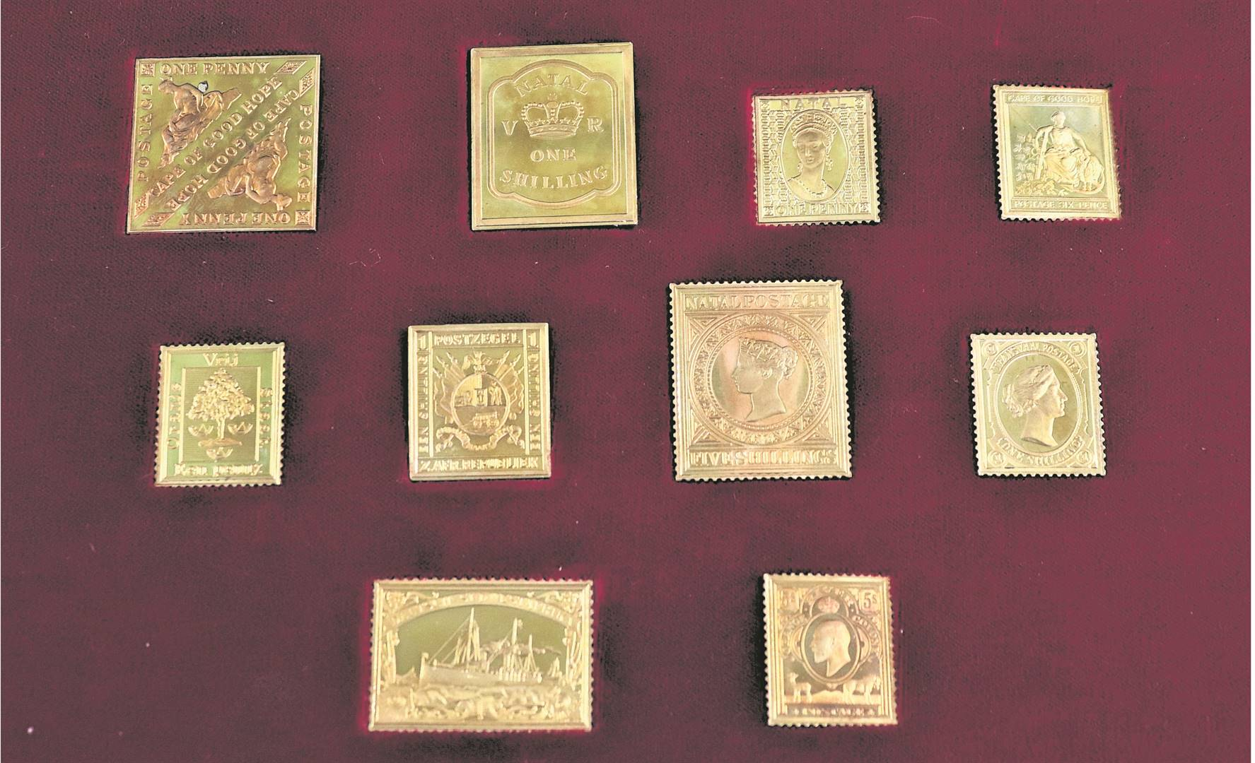 A boxed set of 18ct gold stamps which sold for R85 000 at auction in Hilton.