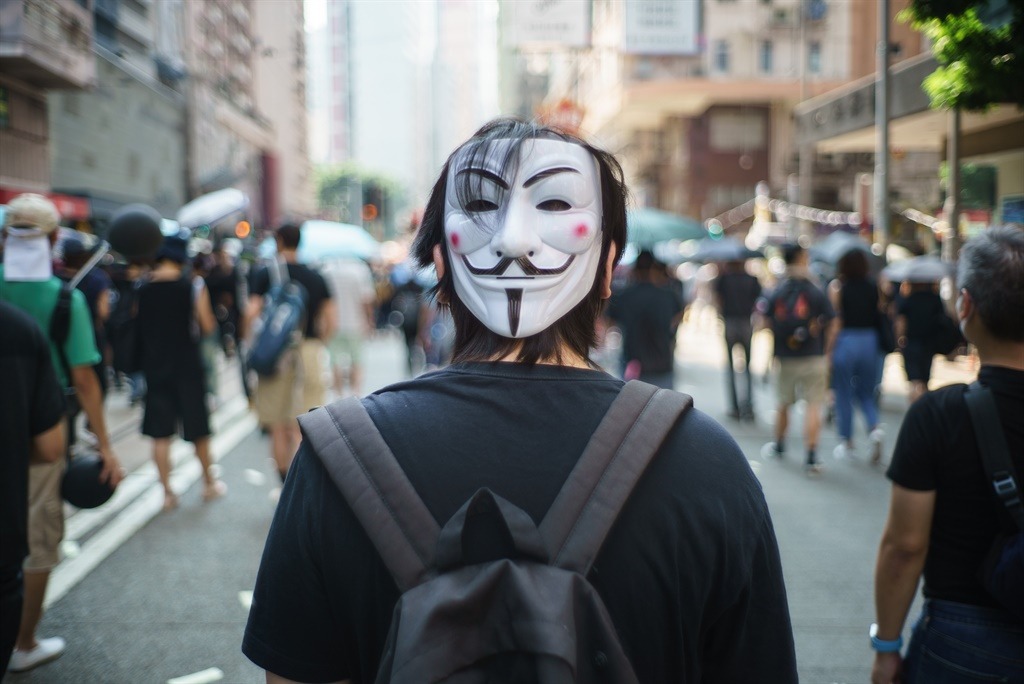 A protester wears a Guy Fawkes mask on the back of his head, popularised by the V For Vendetta comic book film, in Hong Kong. (Yan  Zhao, AFP)