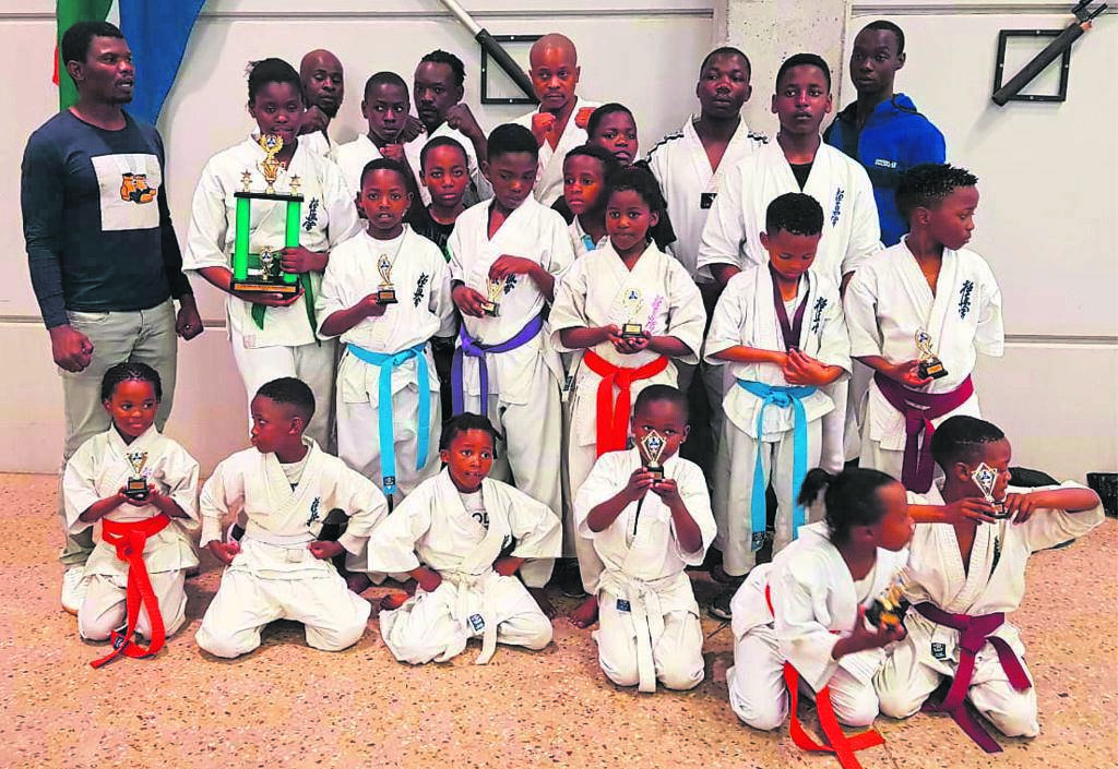 Members of Gugulethu Kyokushin Union Karate Club after the tournament where some of them won trophies.