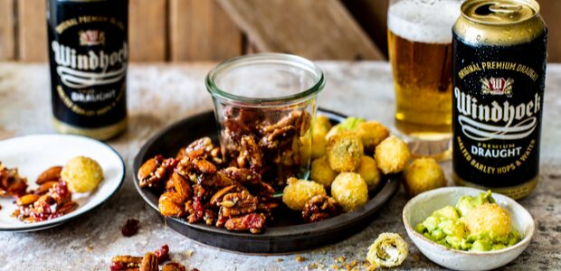 Beer and bacon-glazed nuts with fried olives and g