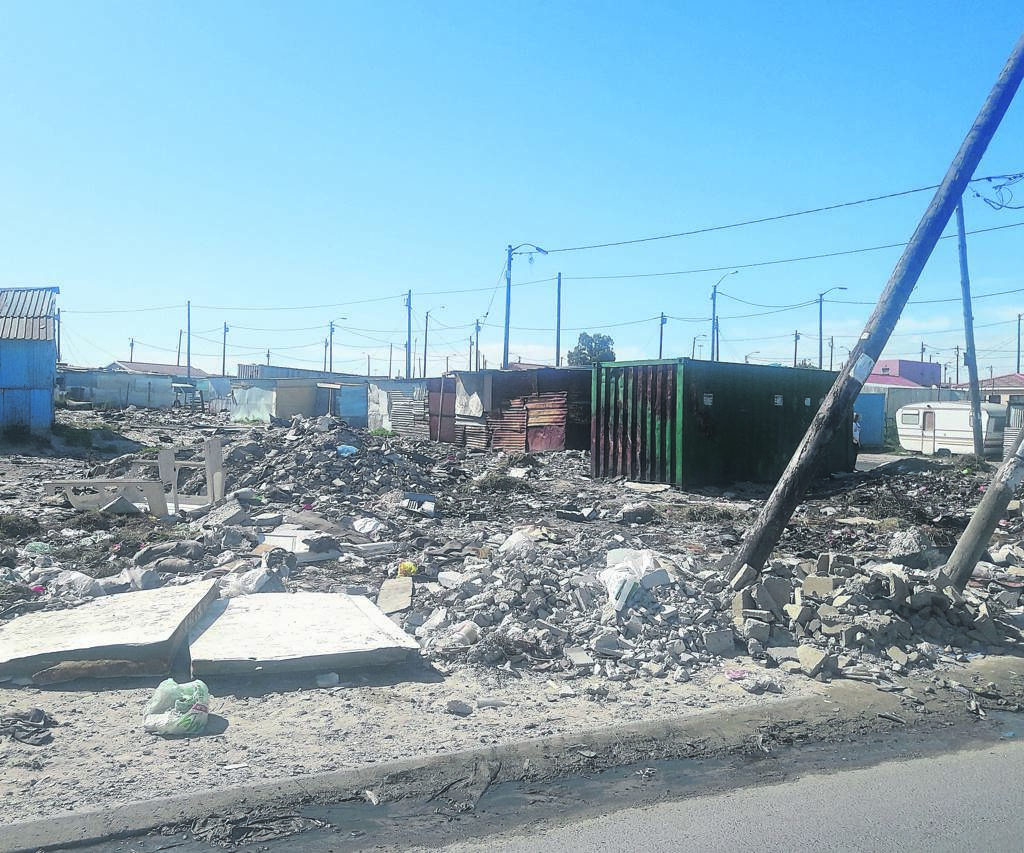 The pile of rubble on the corner of Lerato Ponoane and O Nqubelani Road in Mfuleni.                       PHOTO: UNATHI OBOSE