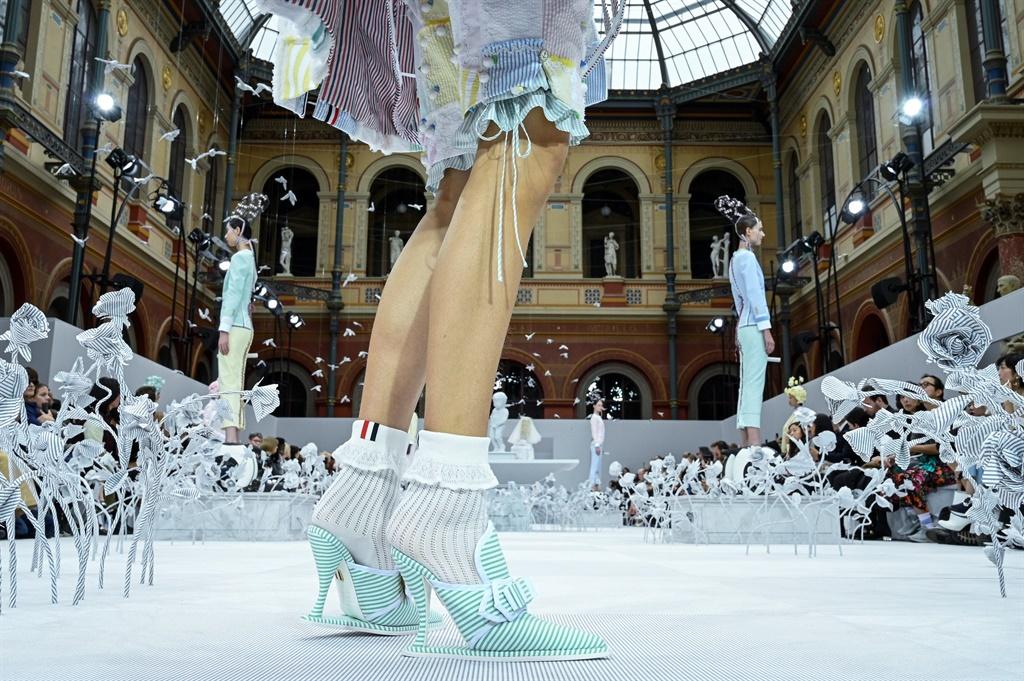 PARIS, FRANCE - SEPTEMBER 29: A model walks the ru