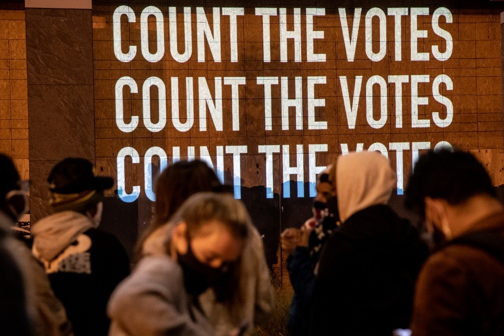After a record-breaking early voting turnout, Americans headed to the polls on 3 November.