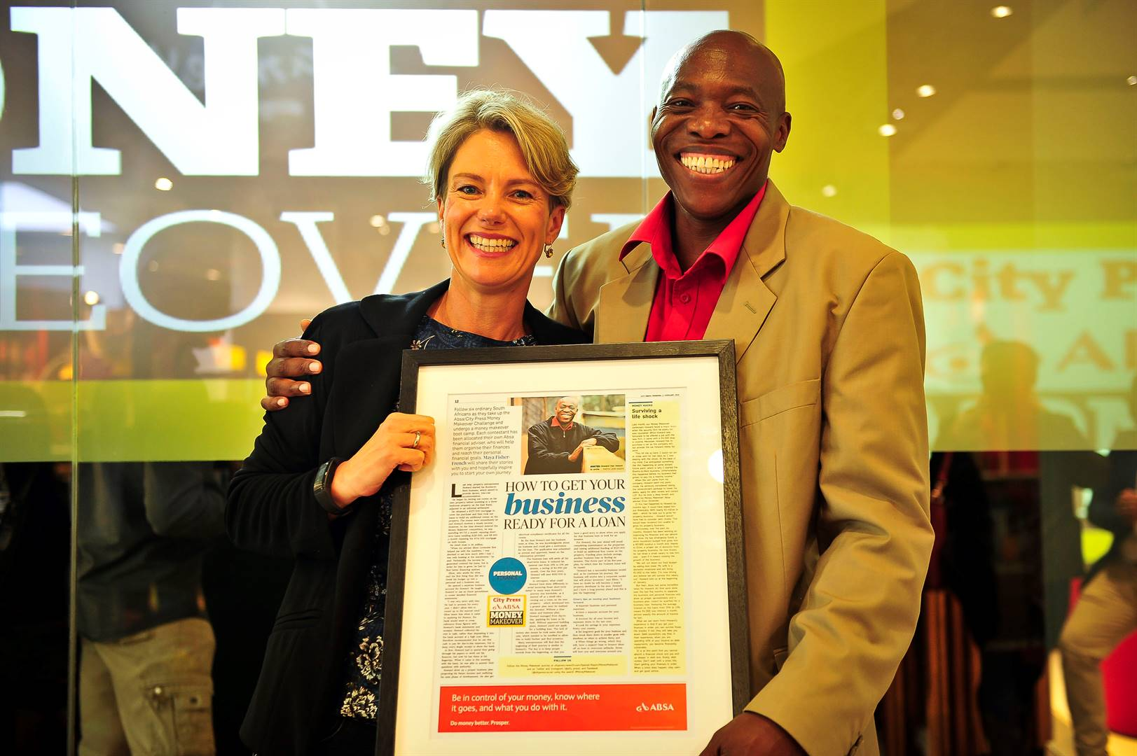 WINNING SMILES Maya Fisher French with Howard after he took top honours after successfully completing the Absa/City Press Money Makeover