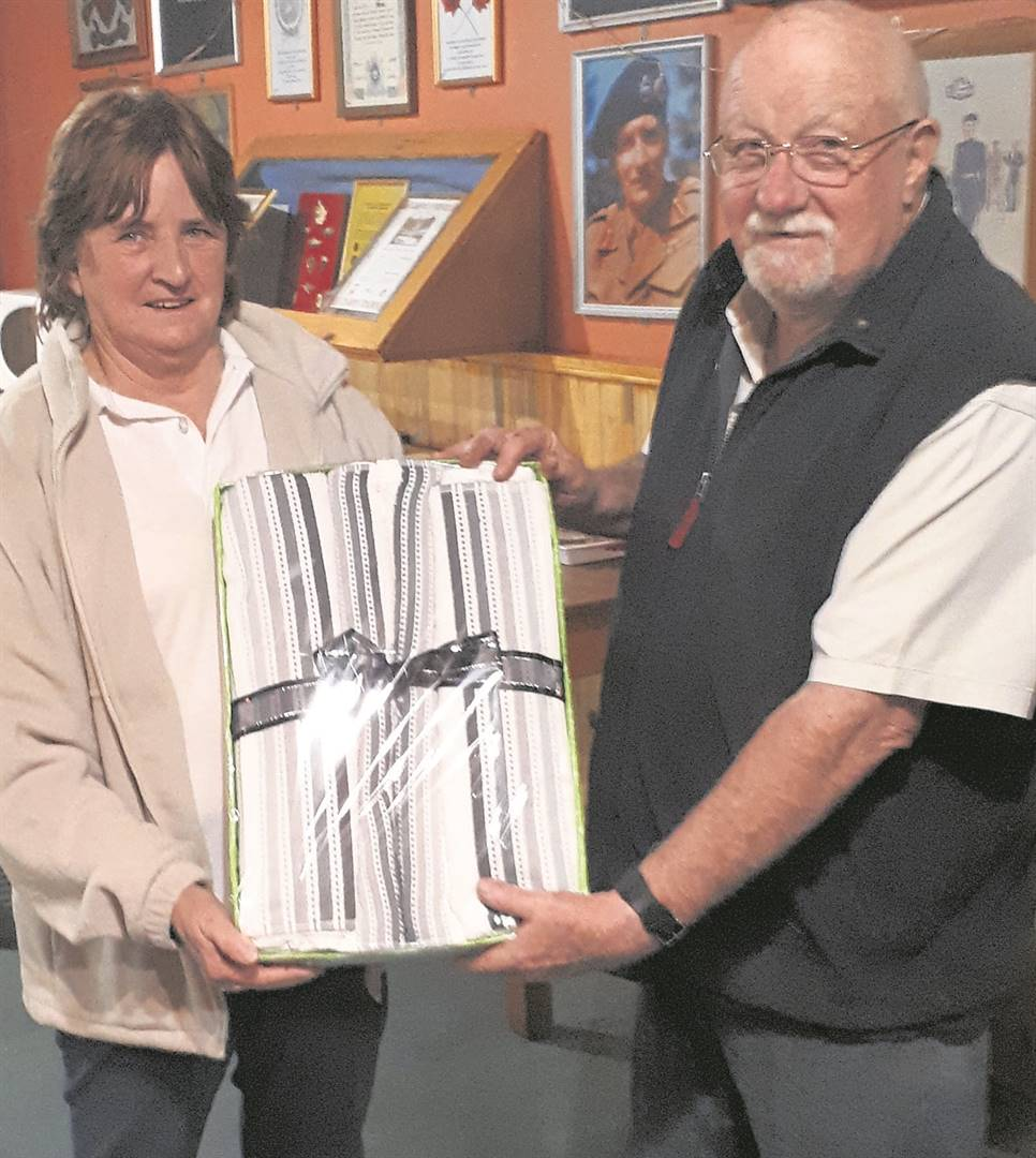 Lady Billie Dulcie Jacobsz (left) hands over the prize to Mike Allan. photo: supplied