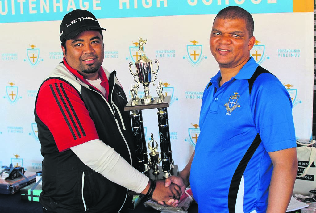 Uitenhage High School, as part of its 55th anniversary celebrations, hosted their annual Golf Day this past Saturday. The winner is Marcel de Klerk (left). Here Mark Williams, principal of Uitenhage High School, congratulates him. The school thanked all the sponsors, stake-holders and players who made this day possible. All funds raised will go towards the building of additional classrooms.                       Photo:SUPPLIED