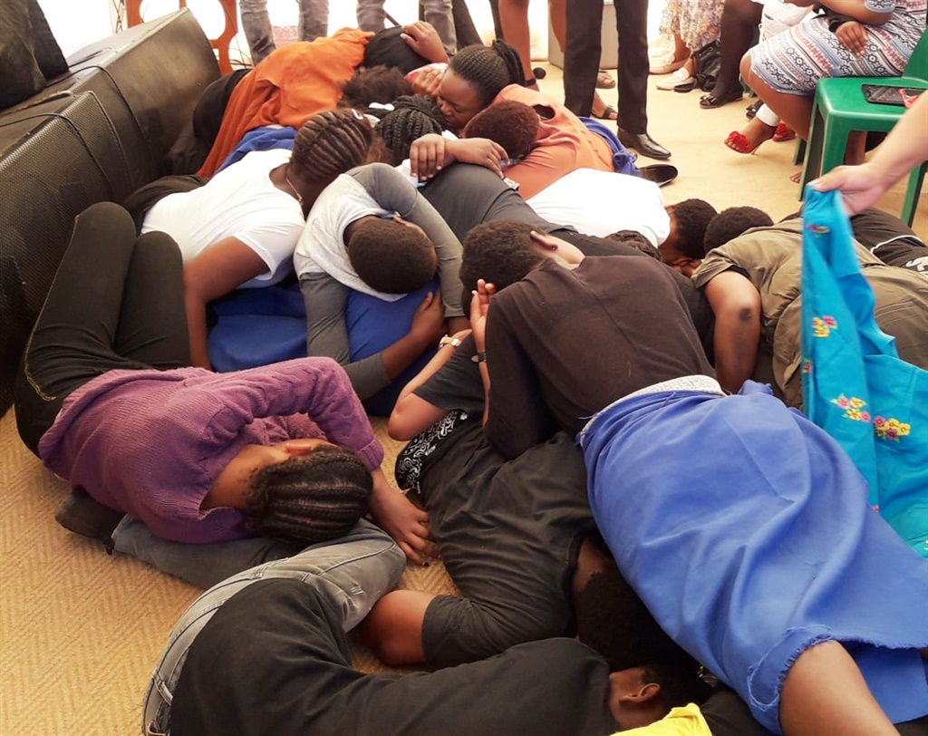 Congregants stacked on top of each other after the