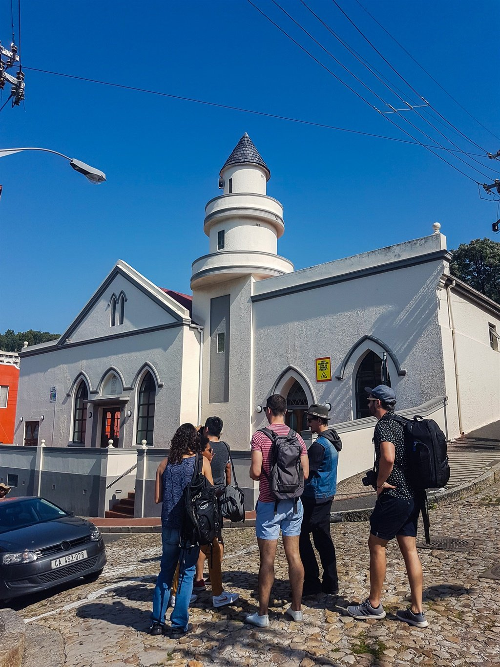 group of tourists outside mosque