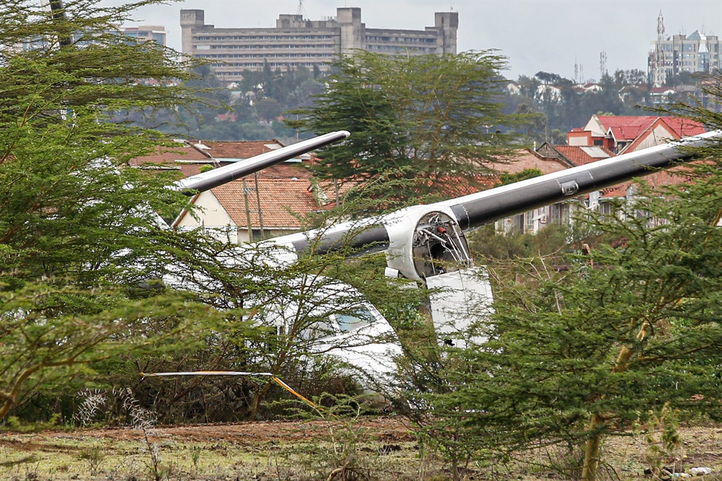 Silverstone Air airline aircraft is seen after it overran the runway on takeoff at Wilson Aiorport, in Nairobi. (Kelly Ayodi, AFP)