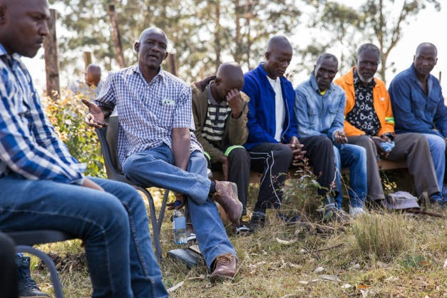 Community leader addresses a meeting of villagers