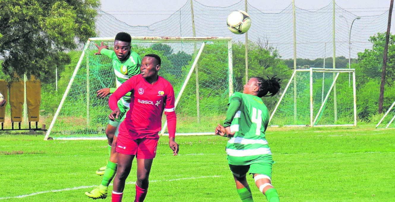 Bloemfontein Celtic women's team defenders Bambanani Mbane (left) and Zihle Chabaku, both in green, tussle for an aerial ball with First Touch Academy goal-getter Noko Matlou (red) during a Safa Women's National League fixture played in Bloemfontein on Saturday (12/10).Photo: Teboho Setena