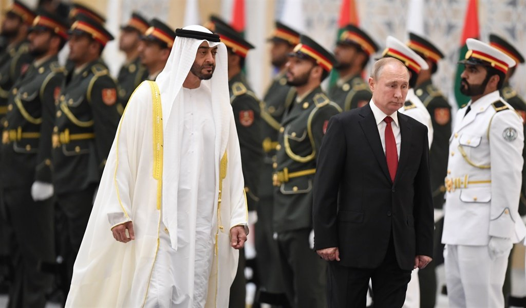 Russian President Vladimir Putin (R) is received by Sheikh Mohamed bin Zayed al-Nahyan, Crown Prince of Abu Dhabi, during an official welcoming in the Emirati capital's Al-Watan presidential palace. (Karim Sahib, AFP)