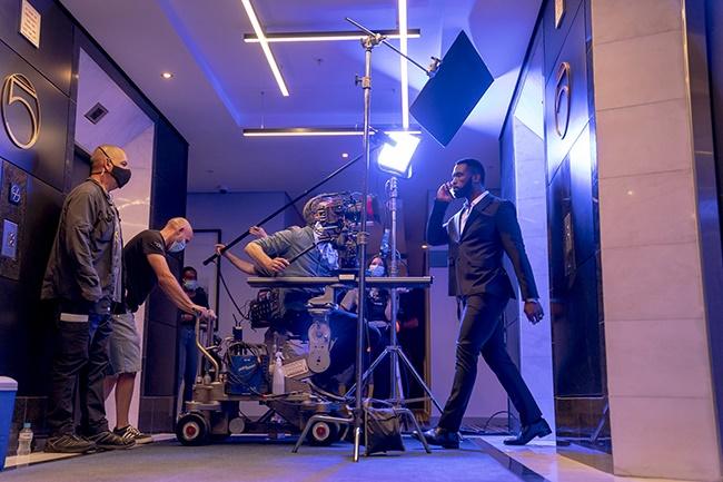 Siya Kolisi all suited up on set. (Photo: Supplied/DStv)