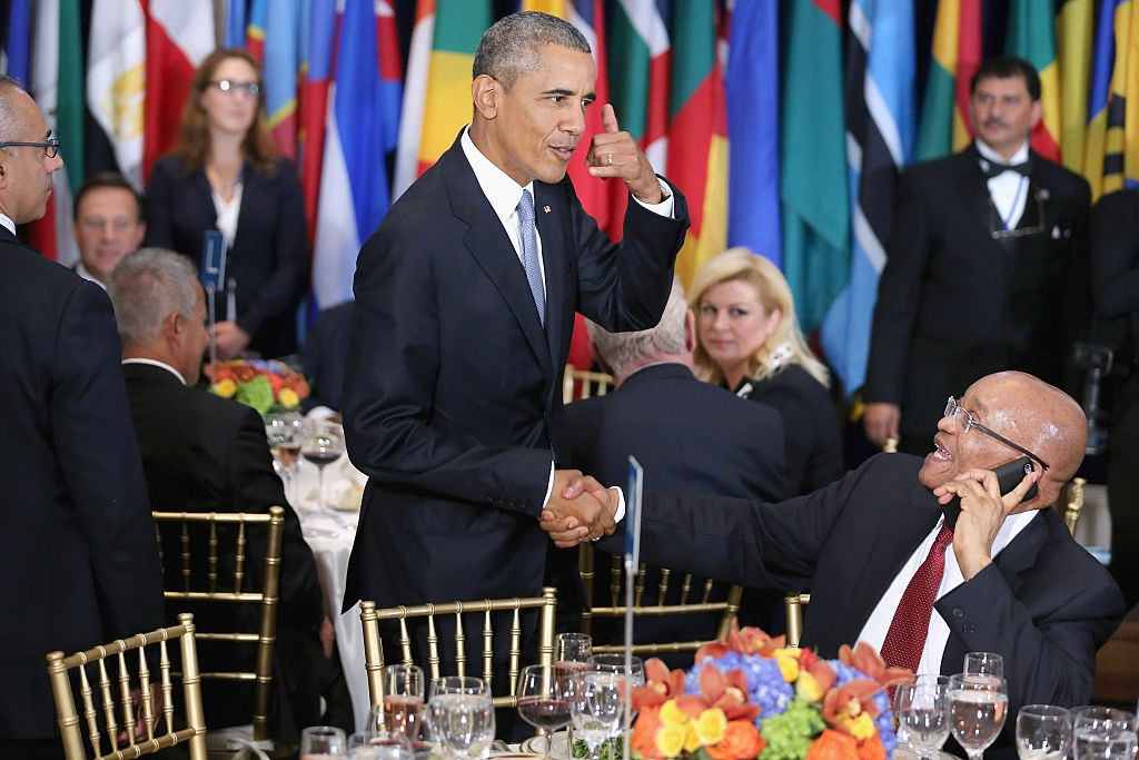 Barack Obama jokes with Jacob Zuma, who was talking on the phone, during a luncheon hosted by United Nations Secretary-General Ban Ki-moon.