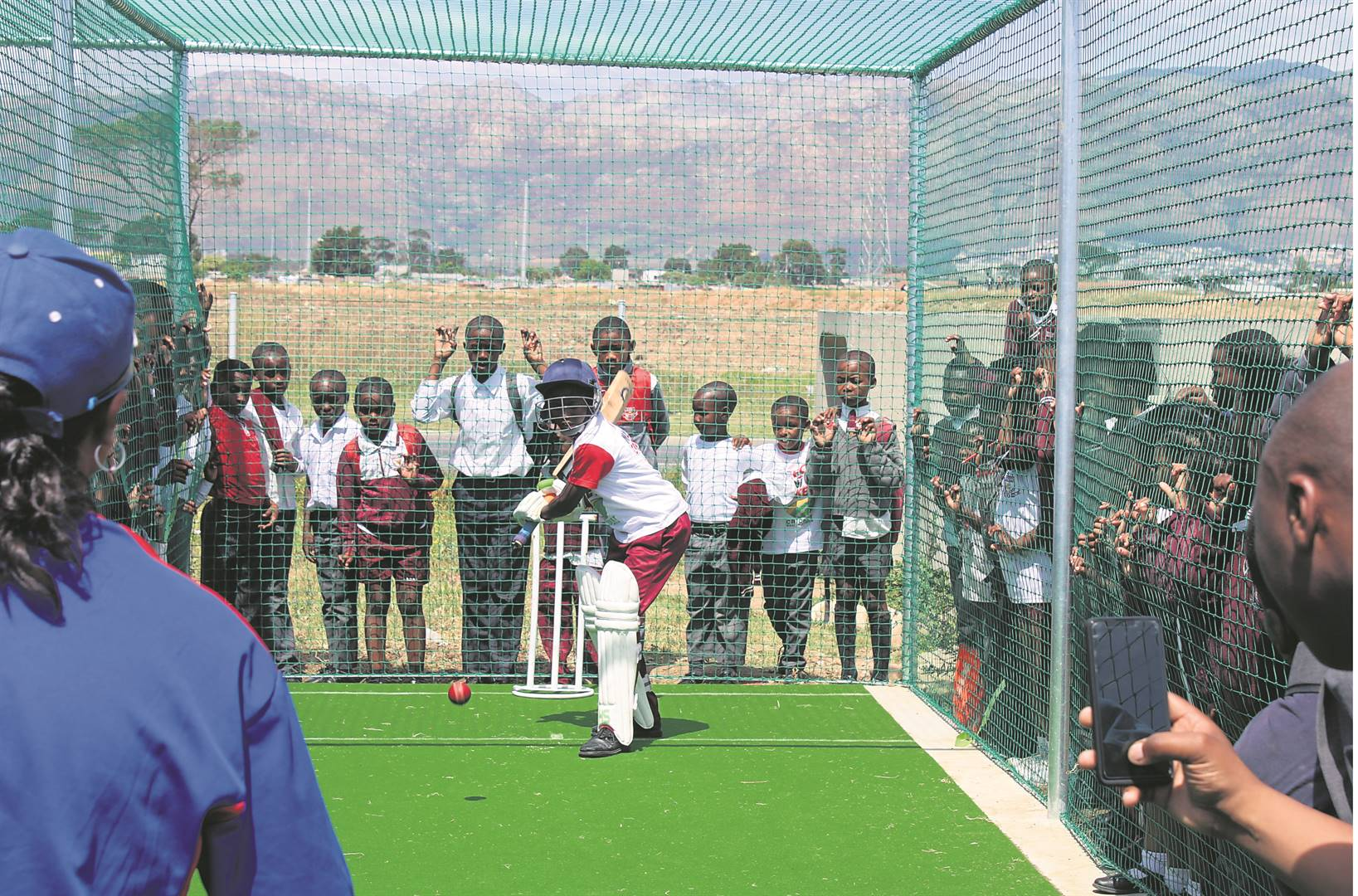 Emihle Matiso (11), a Grade 6 learner at Solomon Qatyana Primary School, swings at a delivery in the newly constructed practice nets at the school. PHOTO: Mzwanele Mkalipi