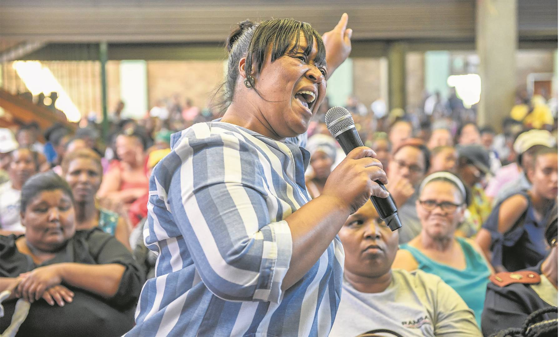 Jenny Solomons questions MEC for Education, Kwazi Mshengu, about corporal punishment at a heated meeting at Eastwood Community Hall on Wednesday.