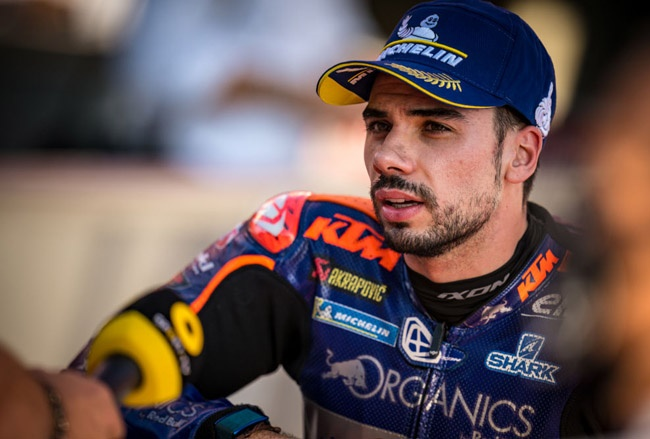 Miguel Oliveira of Portugal and Red Bull KTM Tech 3 speaks to TV station after his pole position at his home grand prix during the qualifying for the MotoGP of Portugal at Algarve Motor Park on November 21, 2020 in Portimao, Portugal.
