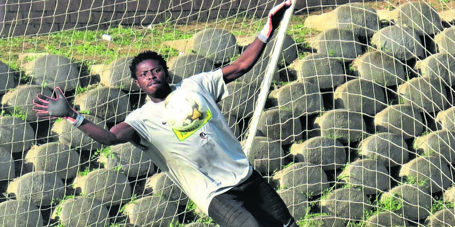 The Central University of Technology goalkeeper Reatile Mafa made a superb save in a derby against Kovsie played recently.Photo: Teboho Setena
