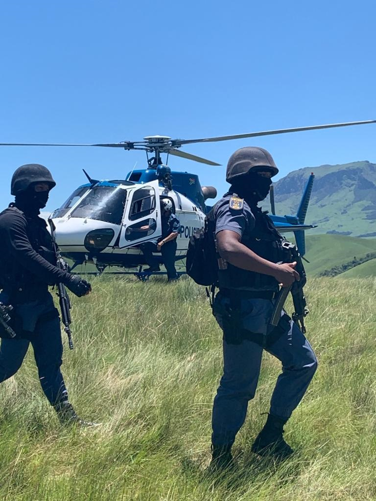 Police searching for suspects wanted for the deadly clash between two groups that left seven people killed.