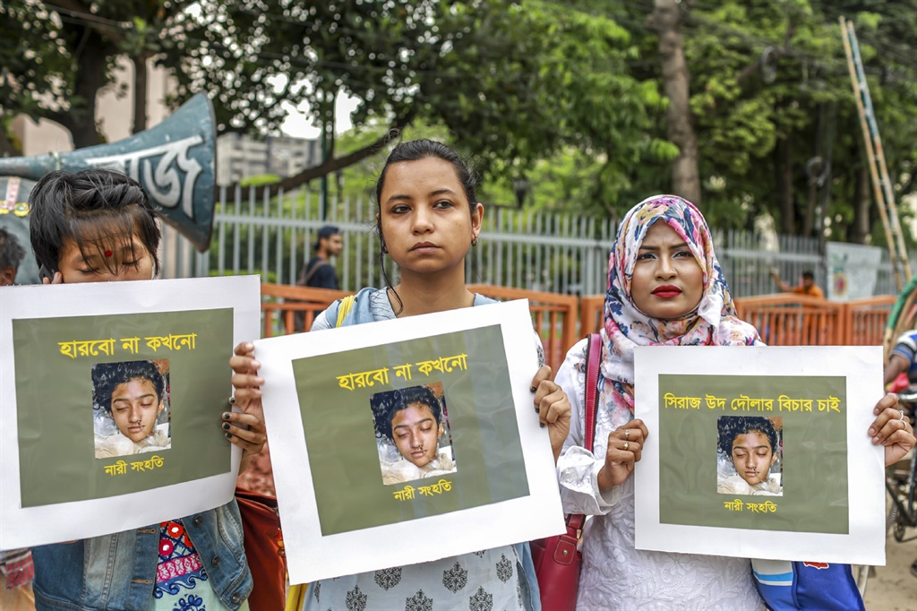 Women hold placards with a photograph of schoolgirl Nusrat Jahan Rafi at a protest in Dhaka, following her murder by being set on fire after she had reported a sexual assault. (Sazzad Hossain, AFP)